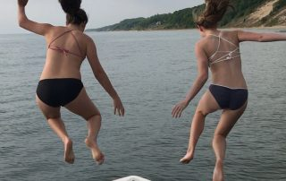 Jumping off the Saugy Dollar to swim in Lake Michigan