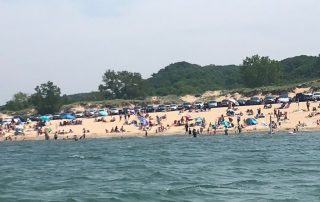 Oval Beach viewed from Lake Michigan on Saugy Dollar Charters